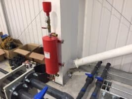 10 The magnetic filter to remove metal particles before water is passed through the pate heat exchanger