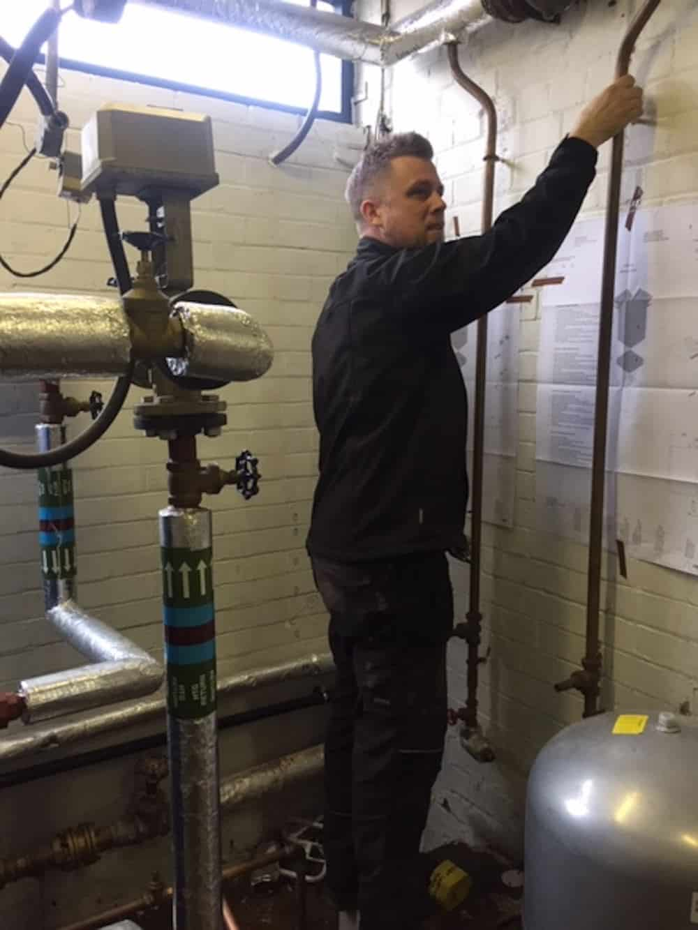 Marking up in the boiler room for the location of the new boilers