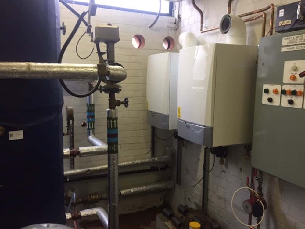 And then after fitting into place the two x 90Kw boilers, designed to fulfil the requirement of 140Kw for heating and 30Kw for hot water.
