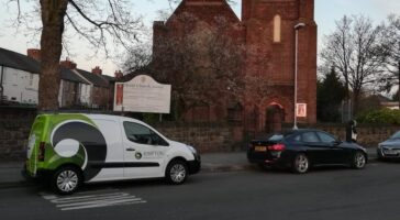 Christchurch in Wallasey with a Kimpton van parked outside