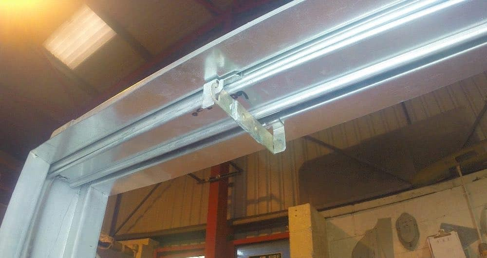 Fusible link in place within a fire damper