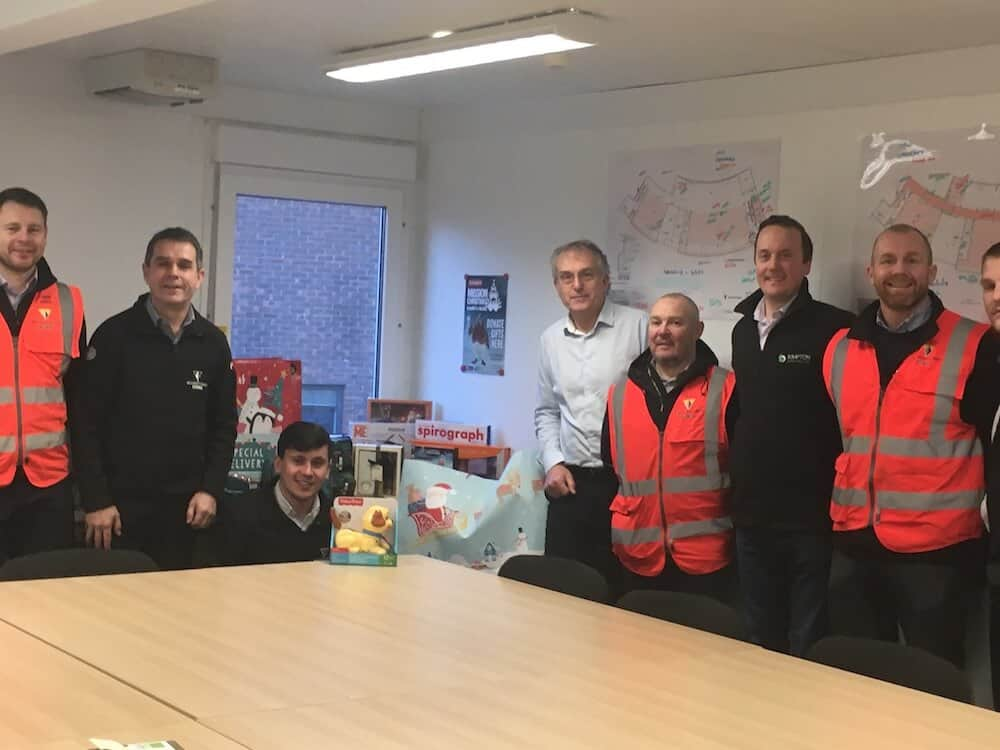 Kimpton with Wilmott Dixon donating to Mission Christmas