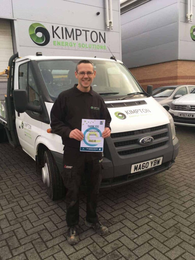 Lee the Kimpton Stores manager with his certificate after raising money for Clatterbridge