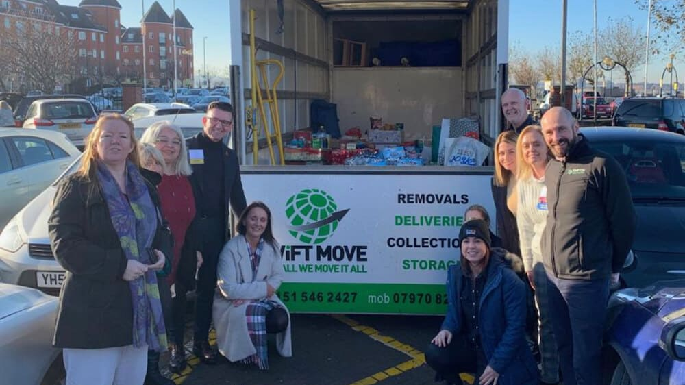 Matt Breakwell donation to Knowsley Food Bank
