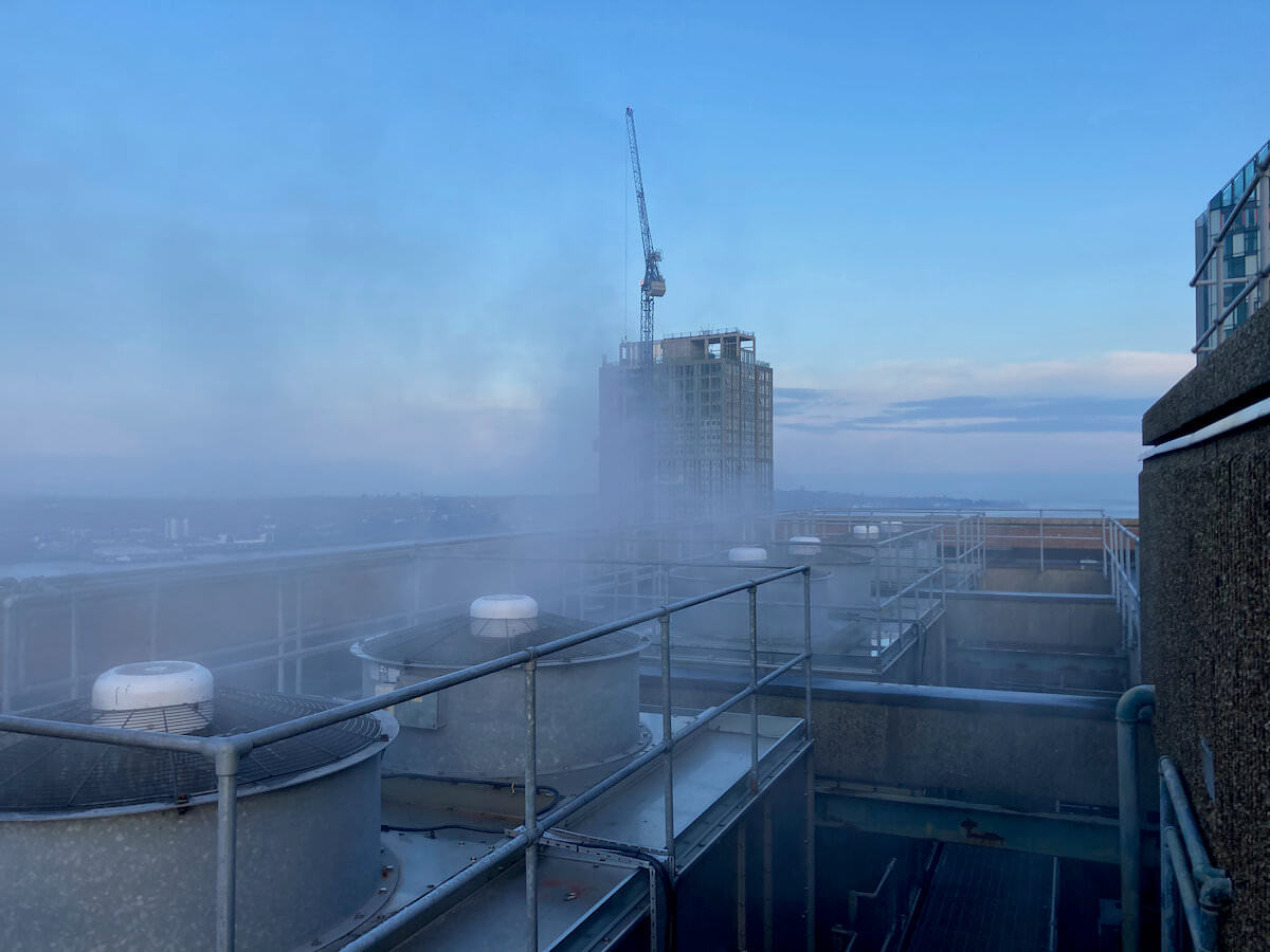 On the very top of the building you can see the cooling system at work