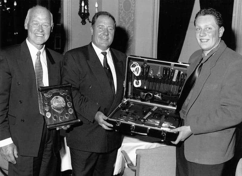 Phil Morgan (pictured far right) receiving the Apprentice of the Year Award with Eric Kimpton (left) looking on