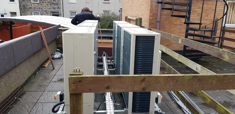 The Condenser units being installed outside on the roof by Kimpton Air conditioning