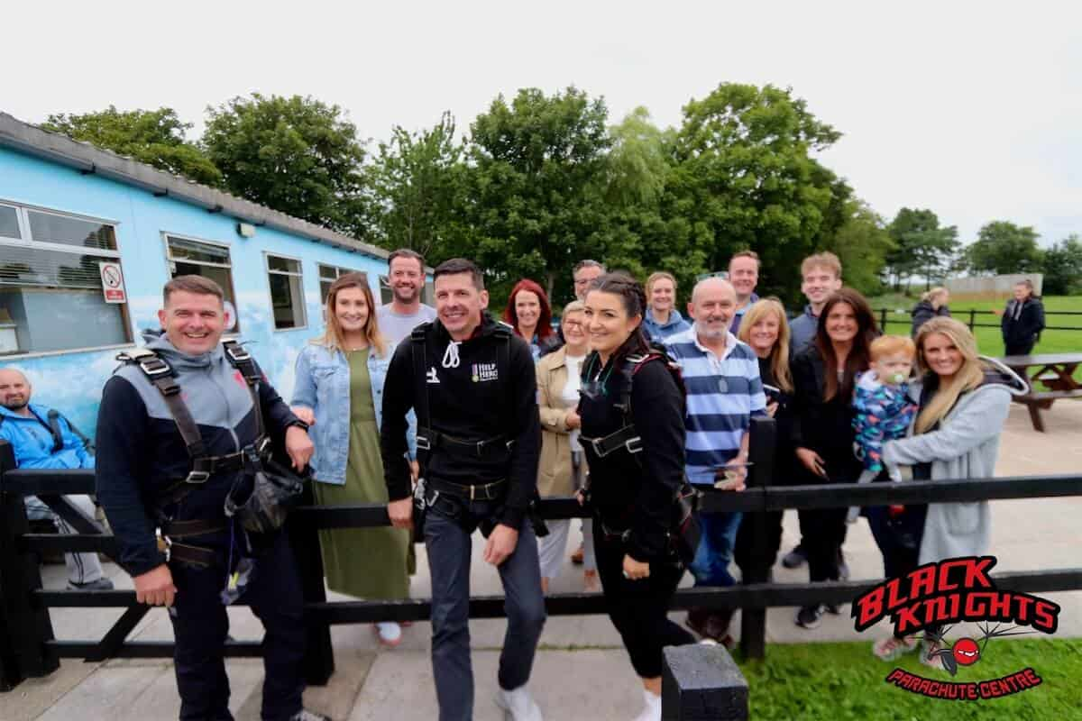 The Kimpton team assemble with their families for the Skydive