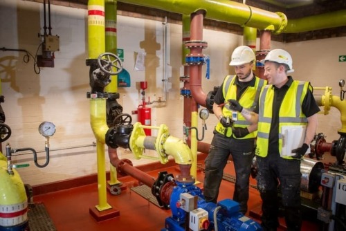 The Kimpton team on site where you can see the scale of pipework needed for commercial plumbing