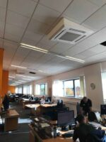 The air conditioning installation in North Wales in an open plan office with a sloping ceiling