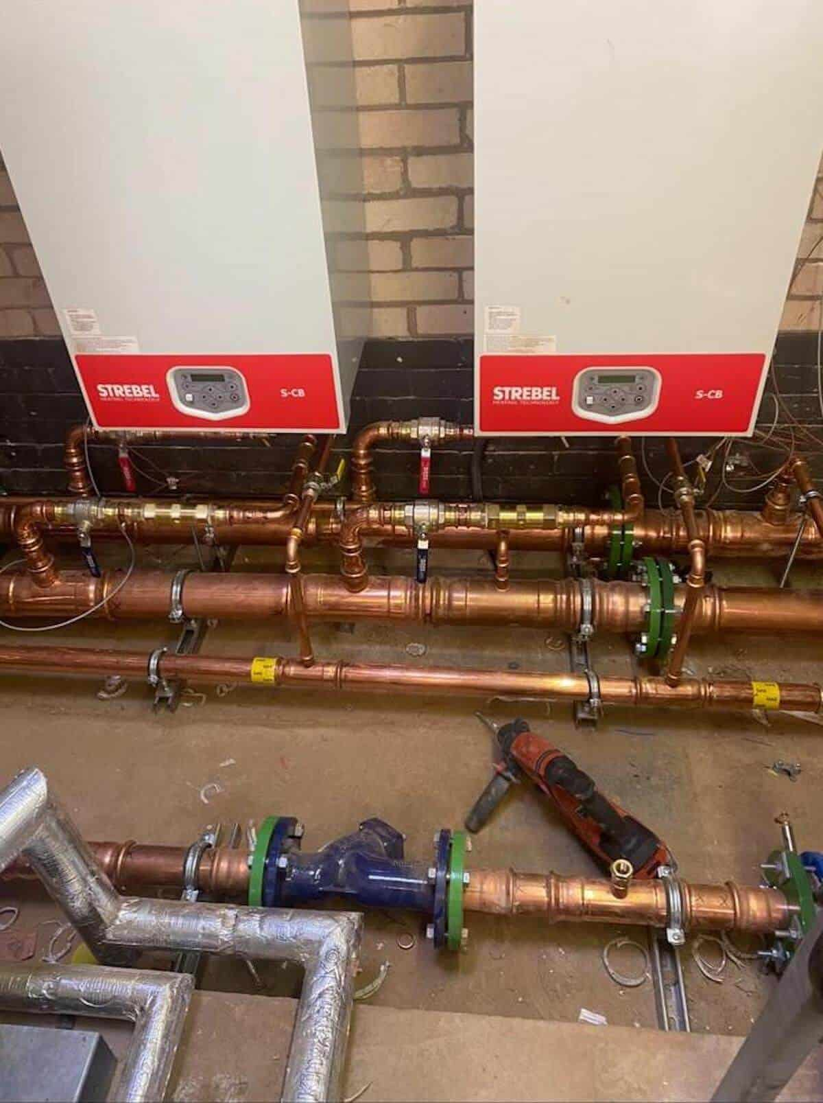 Two new Strebel boilers installed and ready to go with pipework